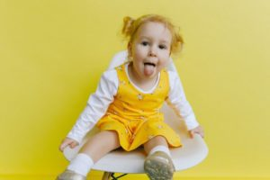 girl-in-white-and-yellow-long-sleeve-dress-doing-funny-face-3771648